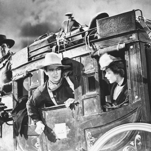 John Wayne, John Ford, Claire Trevor, and Ward Bond close